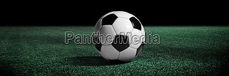 soccer ball on green playground soccer