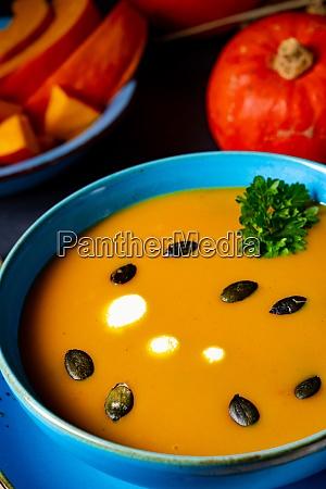 delicious creamy pumpkin soup with coconut