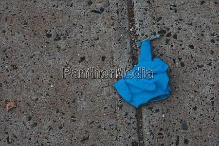 a blue medical glove on the