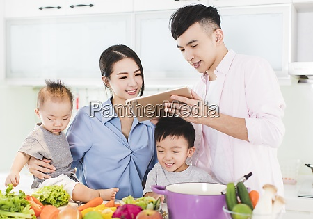 happy family preparing dinner with healthy