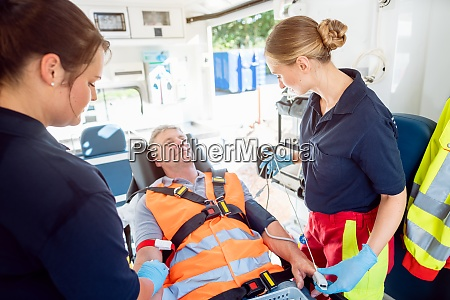 emergency doctor in ambulance talking to