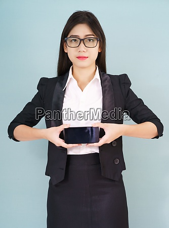 young women in suit holding her