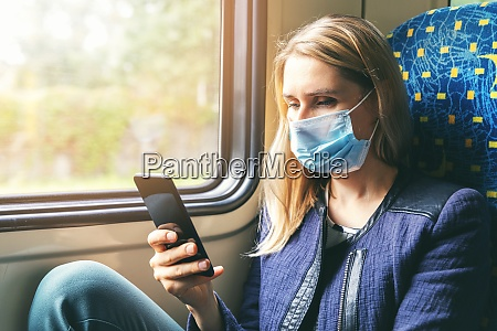 young woman with face mask using