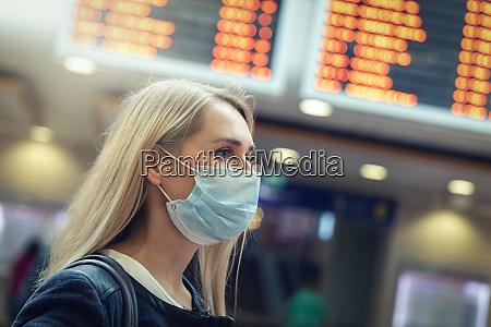 woman wearing protective face mask at