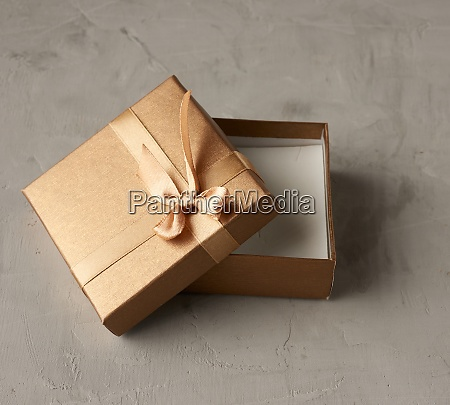 open golden square gift box on