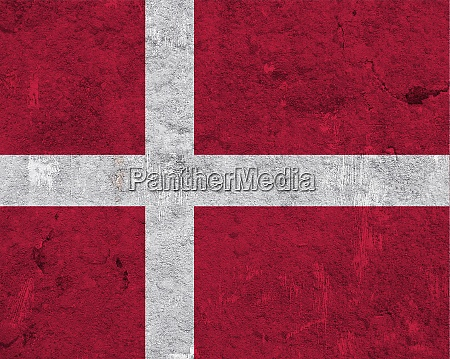 flag of denmark on weathered concrete