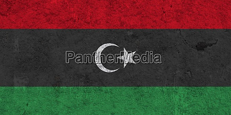 flag of libya on weathered concrete