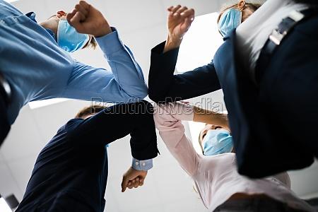 employee doing elbow bump to avoid
