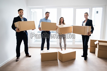 office relocation executives moving cardboard boxes