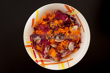salad with carrots on black table