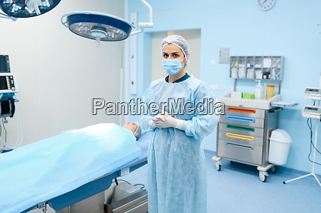 surgeon in gown mask and gloves