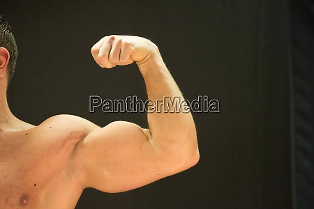 a bodybuilder showing his muscles