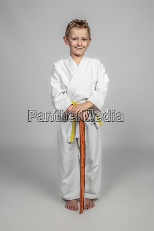 child practicing martial arts