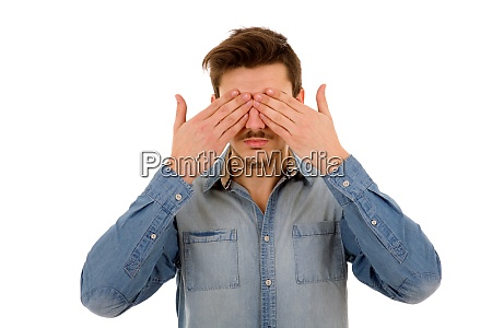 covering his face