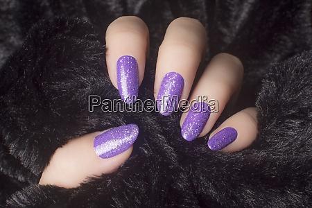 glittered purple nails manicure