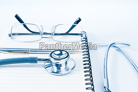 medical stethoscope with blank notepad