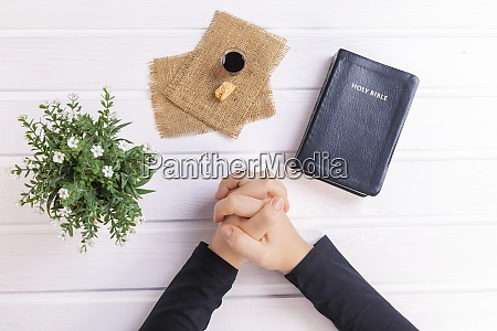 young woman praying and taking communion