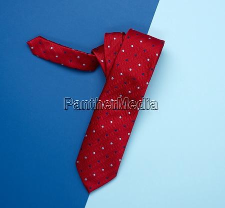 red silk tie on a blue