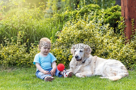 cute liitle baby boy and dog
