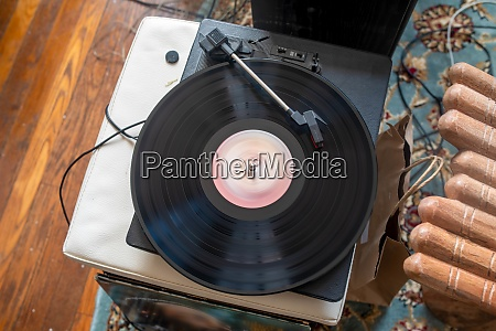 seventies vinyl record spins on turntable