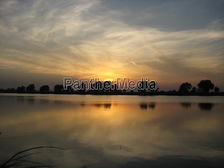 depicts seascape nature landscape sunset on