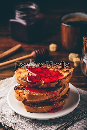 stack of french toasts with berry