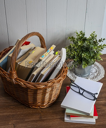 a wicker basket with books