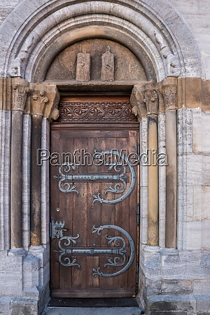 old door with iron ornaments of