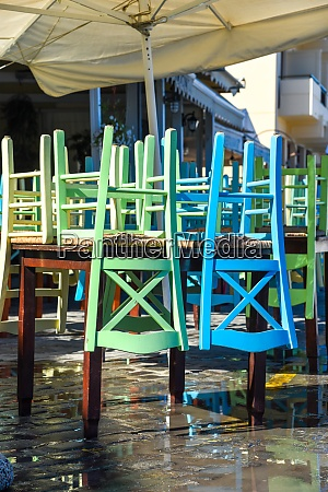 colorful chairs stacked on a table