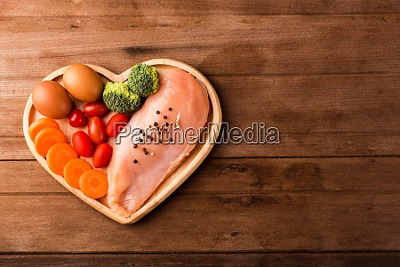 raw chicken breasts fillets in heart