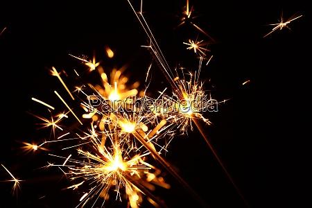 close up several firework sparklers over