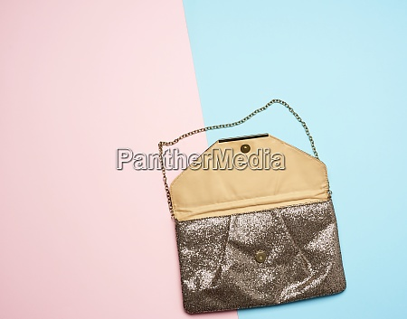 golden leather fashion clutch on a