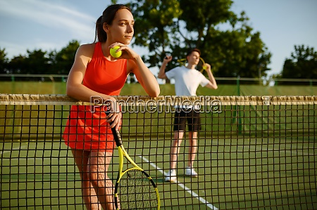 male and female tennis players with