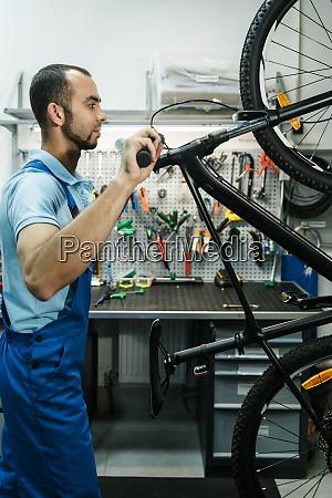 bicycle workshop man finished assembling