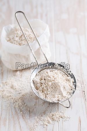 spelt flour in sifter in flour