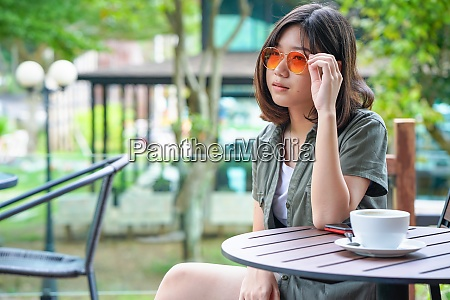 woman sitting in a cafe terrace