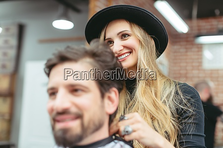 man consulting woman hair stylist for