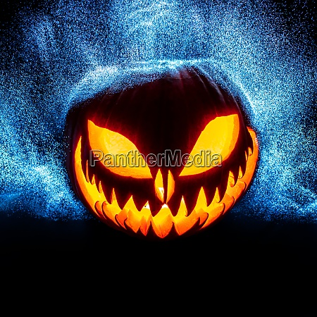 carved halloween pumpkin with bright point