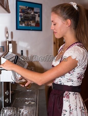 young waitress in dirndl dress