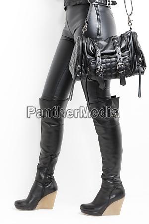 woman with boots and handbag