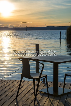 table and seats on the lakeside