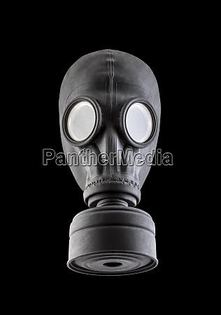 black gas mask isolated on black