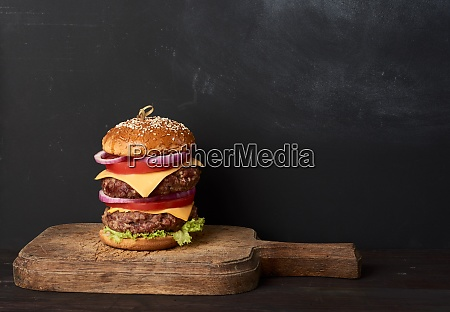double cheeseburger with tomatoes onions barbecue