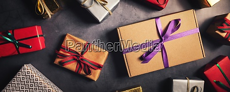 wrapped festive gifts on dark black