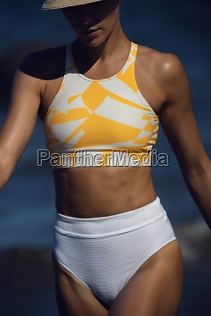 body of fit tanned woman in