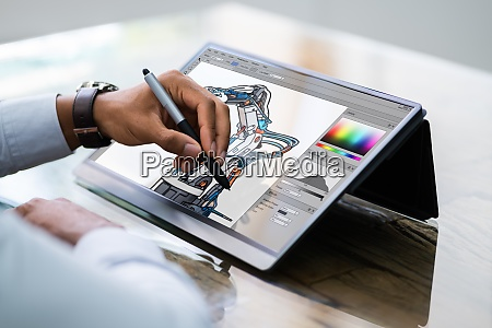african american designer using tablet computer