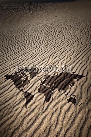 world map against desert sand