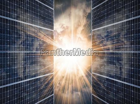 sun shining through solar panels