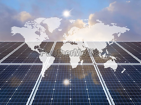 world map over solar panel
