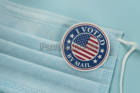 voting sticker and protective mask
